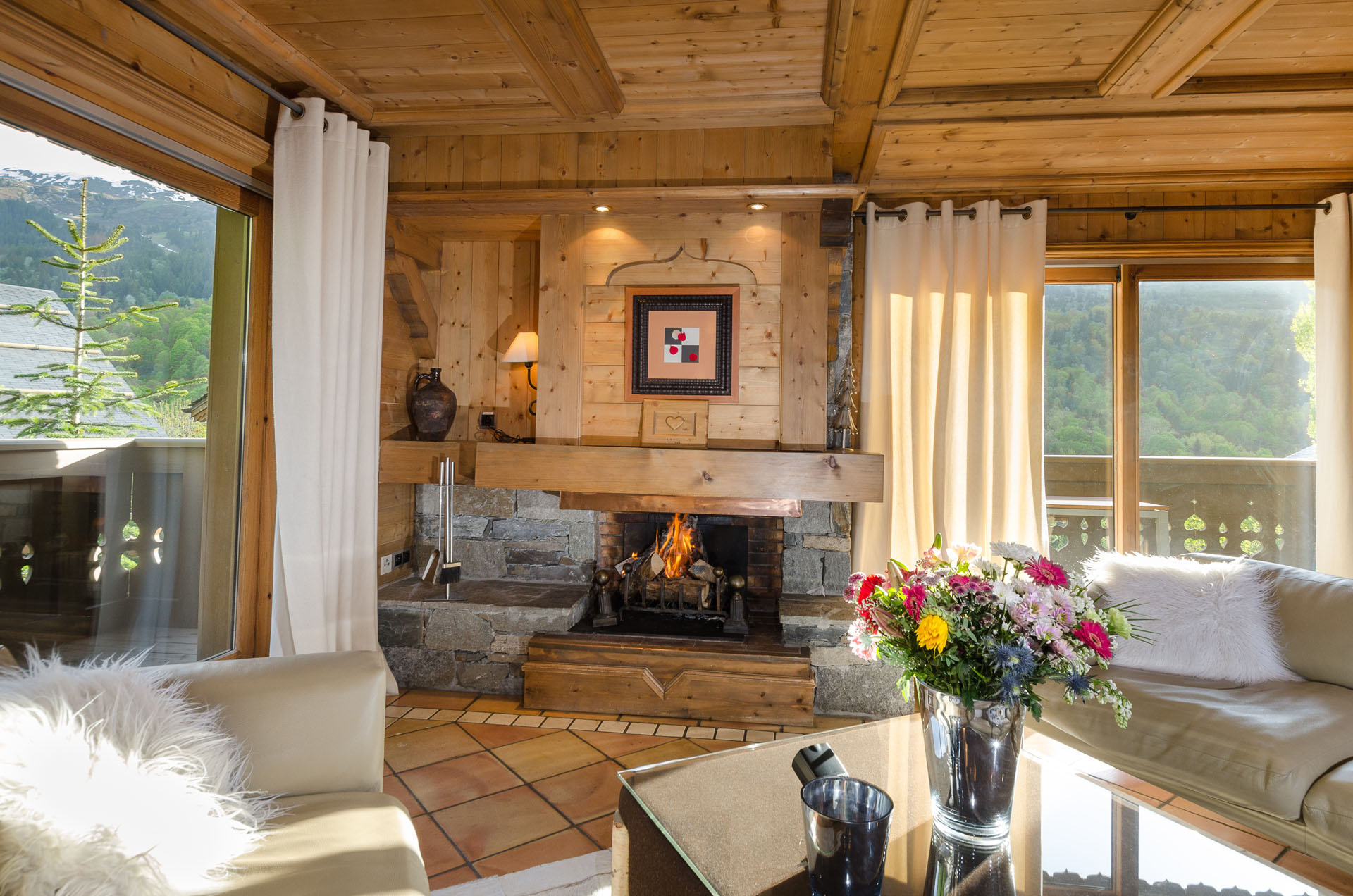 Living Room With Fireplace In This Luxury Chalet