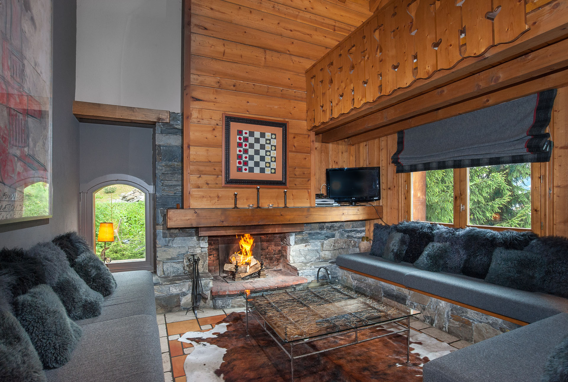 Living Room With Fireplace In 3 Vallées Chalet