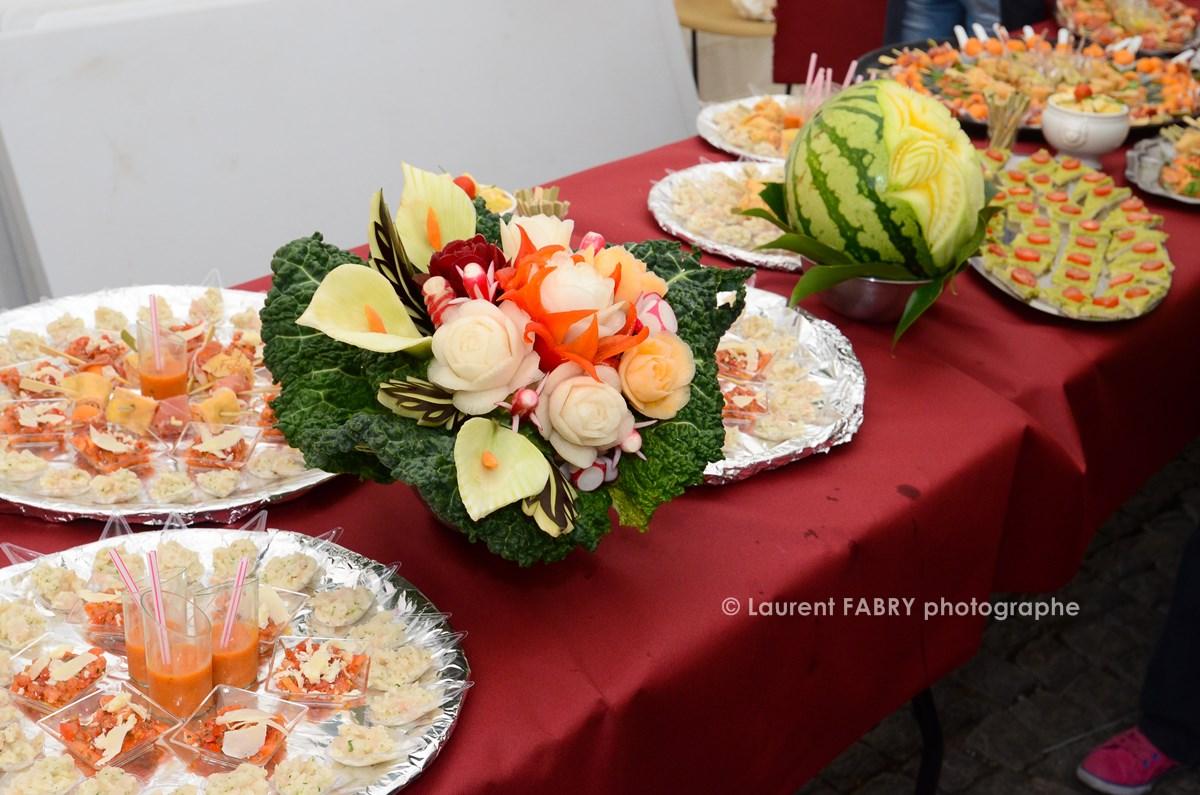 Photographe tourisme en Tarentaise : sculpture sur légumes et buffet à Moûtiers