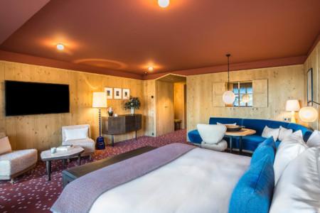 Une Chambre à Coucher Dans Le Chalet D'un Hôtel De Méribel